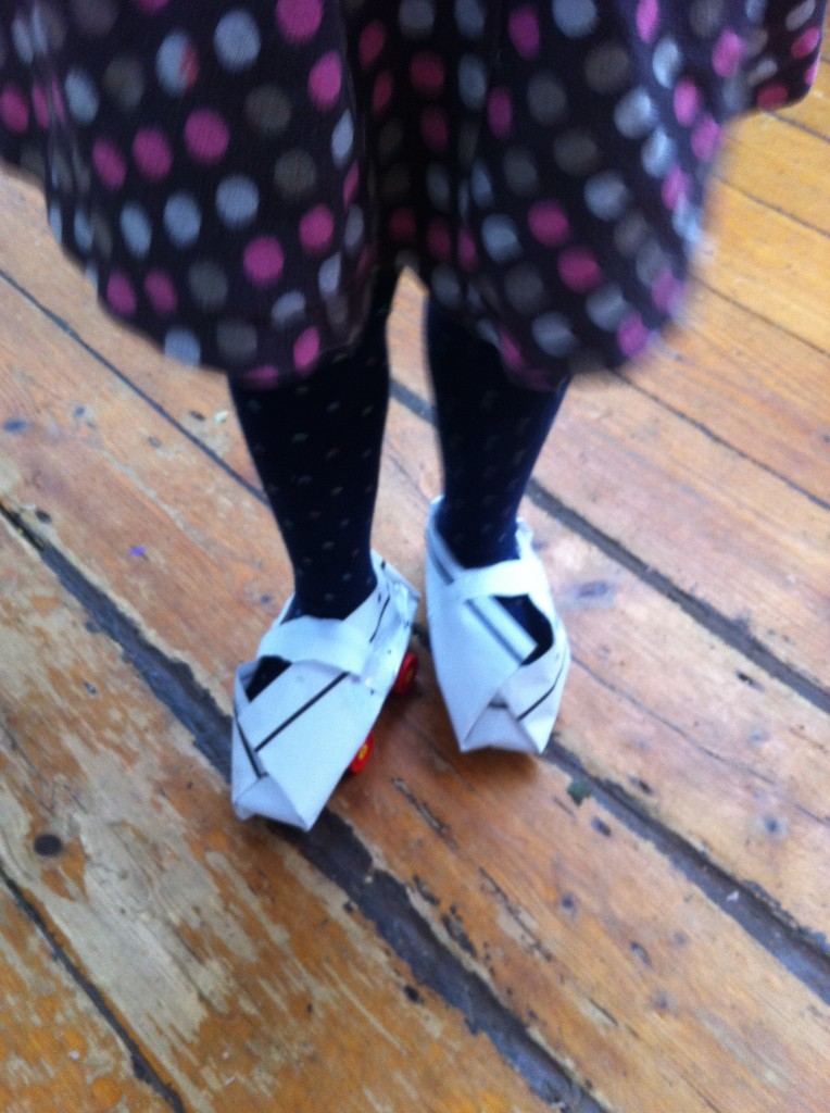 Audrey's home made skates: Lego and paper.