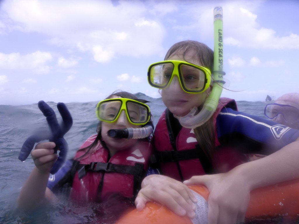 Audrey and Lucinda holding on tight to a starfish and the life buoy - it was a choppy 20 knots.