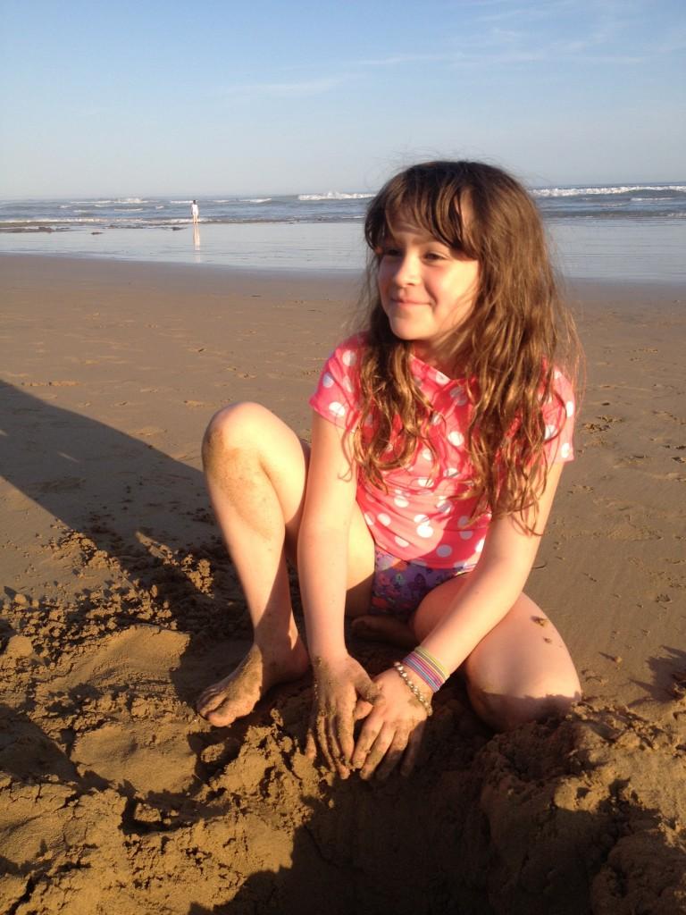 Audrey + sand = happy